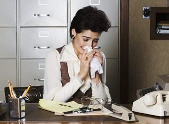 Secretary Crying in Office --- Image by © Push Pictures/Corbis