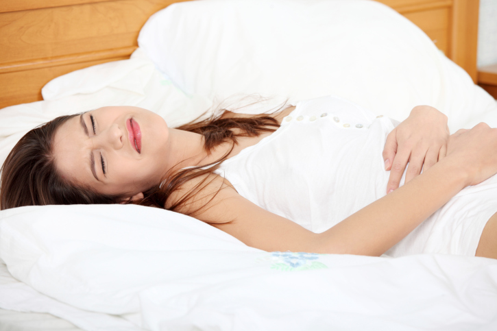 Young woman having stomachache