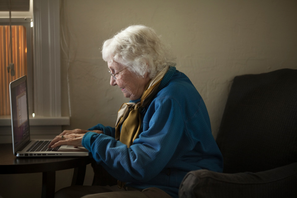 Senior woman working on a laptop computer.