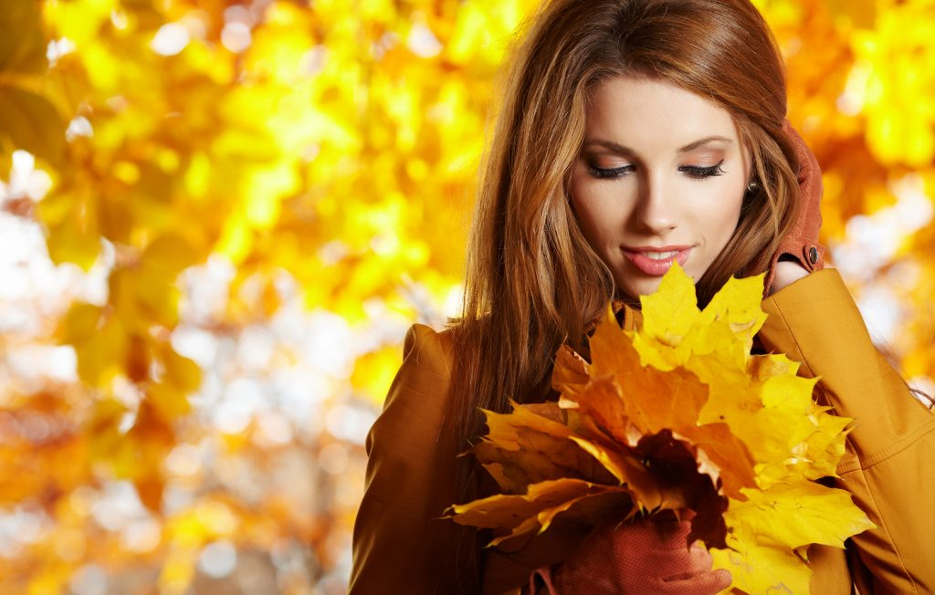 bigstock-young-woman-with-autumn-leaves-25084727